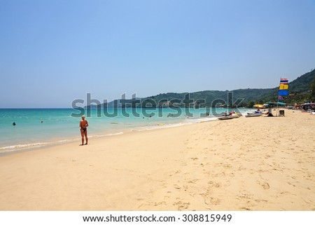 PHUKET, THAILAND - APRIL 13: Tourists vacation on a beach summer and enjoyed in summer day on April 13, 2010 in Phuket, Thailand. It is a popular the famous for patong beach - stock photo