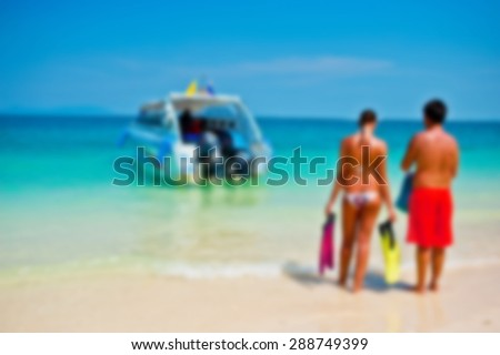 PHUKET THAILAND - Blur background tourists stand waiting speed boat on the beach and blue sky  - stock photo