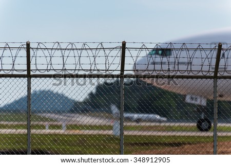 Phuket, Thailand - December 6, 2015 : Emirates airline Boeing 777 taxi for departure behind airport fence at Phuket Airport - stock photo