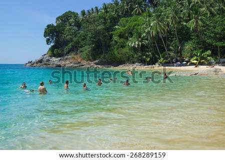 PHUKET, THAILAND  - FEB 24, 2015: People bathe in the Bay of the Andaman sea.  Many tourists prefer to come to Phuket in February. Phuket , Thailand, February 2015 - stock photo
