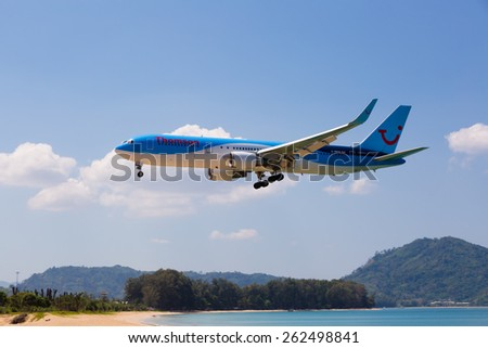 Phuket,Thailand -  February 23, 2015: beach near the airport, planes come in the land