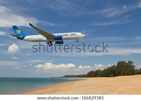 PHUKET , THAILAND- FEBRUARY 09,2013: Passengers boarding airplane Airbus A330 of Thomas Cook landing in airport of Phuket on February 09,2013
