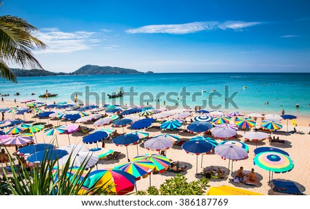PHUKET, THAILAND- JAN 23, 2016: Crowds of tourists at Patong beach on  Jan 23, 2016 in Phuket, Thailand. Phuket is a popular destination famous for its beaches. - stock photo