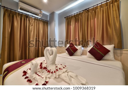 PHUKET, THAILAND -JANUARY 20 : Interior of a bedroom in a hotel at Phuket Thailand on JANUARY 20,2016.