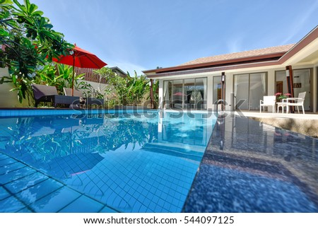 PHUKET, THAILAND - JUNE 7 : Exterior Modern Tropical Villa with Swimming Pool for a new family on JUNE 7, 2016, in Phuket Thailand.