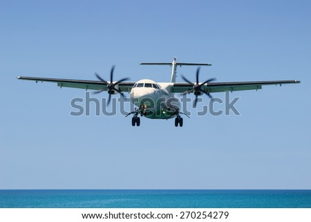 PHUKET, THAILAND, MAR 02 2015: Turboprop aircraft ATR 72-212A (500) - MSN 833 - HS-PGD Airline Bangkok Airways. Landing in Phuket International Airport in Thailand, flies from the ocean - stock photo