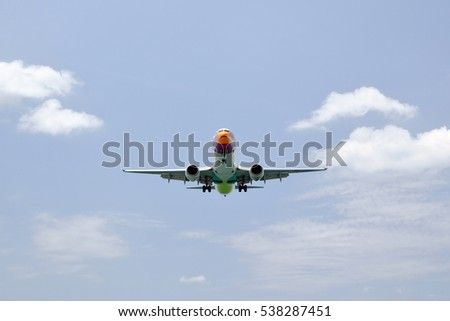 Phuket, Thailand - March 1, 2016: A jet landing at the airport on Mai Khao beach, Phuket island.