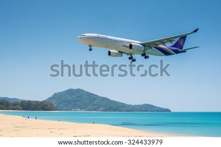 PHUKET, THAILAND - MARCH 11: Landing airplane at Phuket international airport on 11 March, 2014.  - stock photo