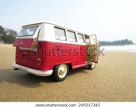 PHUKET, THAILAND - MARCH 27, 2015: Miniature VW Bulli 1962 on the beach. The cult car of the Hippie generation and it remained the status vehicle of the high wave surfers. - stock photo