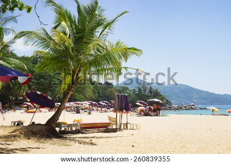 PHUKET, THAILAND - MARCH 3: People relax on the ocean in Thailand. Here there is still secluded beaches, the epicenters of peace and quiet. - stock photo
