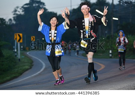 PHUKET,THAILAND-MAY05:Isao Suzuki no.1389 and Satomi Kasuya no.1433 from Japan run during the Laguna Phuket International marathon at Laguna Phuket Resorts and Hotels on May05,2016 in Phuket,Thailand. - stock photo
