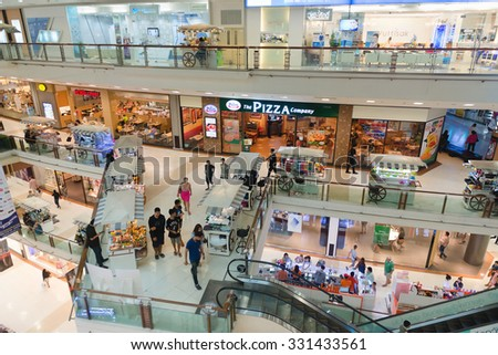 PHUKET, THAILAND - 23 MAY 2014:  Looking out from the top floor, over the multiple levels of Central Festival Mall, one of the region's premier shopping destinations. - stock photo