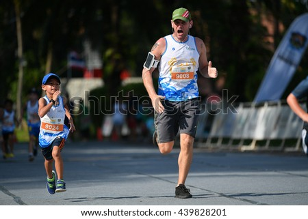 PHUKET, THAILAND - MAY 04: Unidentified father with son run the Kids' Run at the Laguna Phuket International marathon at Laguna on May 04, 2016 in Phuket, Thailand.   - stock photo