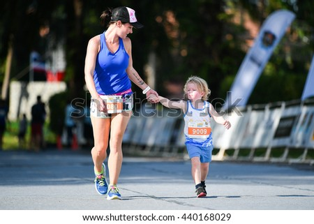 PHUKET, THAILAND - MAY 04: Unidentified mother with son run in a Kids' Run race during the Laguna Phuket International marathon at Laguna on May 04, 2016 in Phuket, Thailand. - stock photo