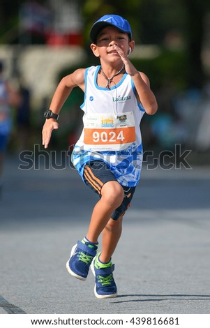 PHUKET, THAILAND - MAY 04: Unidentified young athletes run in a Kids' Run race during the Laguna Phuket International marathon at Laguna on May 04, 2016 in Phuket, Thailand. - stock photo