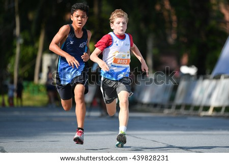 PHUKET, THAILAND - MAY 04: Unidentified young athletes  the Kids' Run at the Laguna Phuket International marathon at Laguna on May 04, 2016 in Phuket, Thailand.  - stock photo