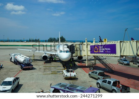 PHUKET, THAILAND - NOV 11: airbus docked at airport on November 11, 2014. Phuket International Airport is an airport serving Phuket Province of Thailand. It is the second busiest airport in Thailand - stock photo