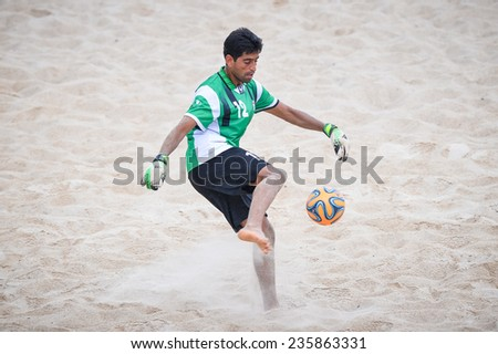 PHUKET THAILAND-NOV19:Goalkeeper Hamid Behzadpour of Iran kicks the ball during the Beach Soccer match between Iran and Thailand the2014 Asian Beach Games at Saphan Hin on November19,2014 in Thailand  - stock photo