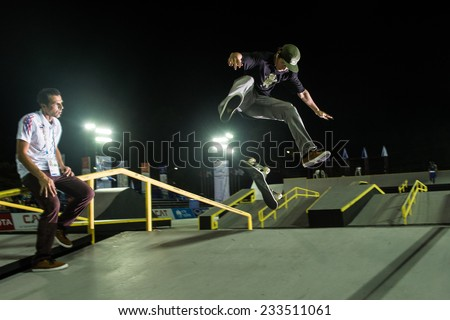 PHUKET THAILAND-NOV 16:Head coach Eric Kirk wood (L) look on Athiwat Rueangsri of  Thailand  in action during  Skateboard practice  the 2014 Asian Beach Games at Saphan Hin on Nov 16,2014 in Thailand