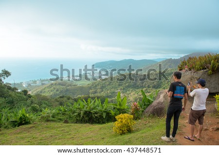 Phuket-Thailand 28NOV-2014:Undentified people looking at the ocean from viewpoint on the mountain