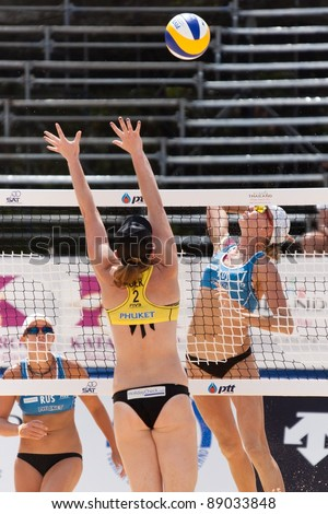PHUKET, THAILAND - NOVEMBER 3: Ekaterina Khomyakova of Russia in action during a match on day 3 of SWATCH FIVB World Tour 2011 on November 3, 2011 at Karon Beach in Phuket, Thailand - stock photo