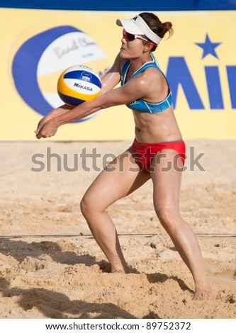 PHUKET, THAILAND - NOVEMBER 3: Kamoltip Kulna of Thailand in action during a match on day 3 of the SWATCH FIVB World Tour 2011 on November 3, 2011 at Karon Beach in Phuket, Thailand