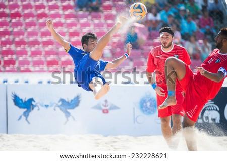 PHUKET THAILAND-NOVEMBER16:Komkrit Nanan (blue)of Thailand bicycle kick during the Beach Soccer match between Kuwait and Thailand the 2014 Asian Beach Games at Saphan Hin on Nov16,2014 in Thailand - stock photo