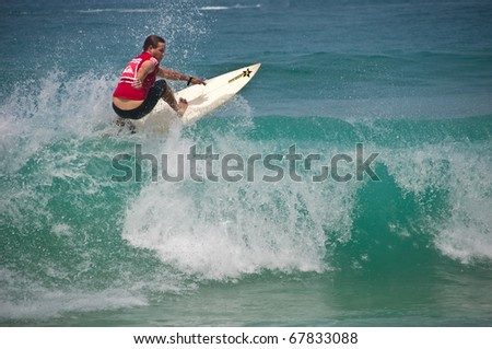 PHUKET THAILAND - NOVEMBER 26 : Lee Dowse rides on top of the wave during Quiksilver competition at Kata Beach Nov 26, 2010 in Phuket.