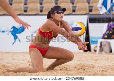 PHUKET THAILAND-NOVEMBER21:Meim ei Lin of China sets the ball during the Beach Volleyball match between China and Thailand the 2014 Asian Beach Games at Karon beach on Nov 21,2014 in Thailand