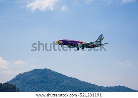 Phuket, Thailand - November 18,  2016: plane landing over the sea