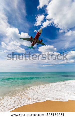 Phuket, Thailand - November 25,  2016: plane landing over the sea