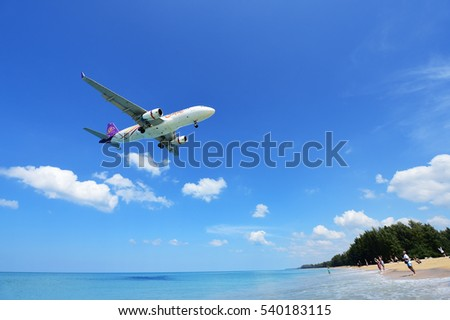 PHUKET, THAILAND - NOVEMBER 17 : The airplane landing at Phuket airport over the Mai Khao Beach on November17, 2016 in Phuket, Thailand.