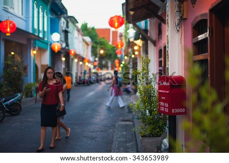 Phuket, Thailand 21 november 2014: Visitors walk Chinatown in Phuket, Thailand. Phuket Chinatown is the largest in Thailand and a popular tourism attraction. - stock photo