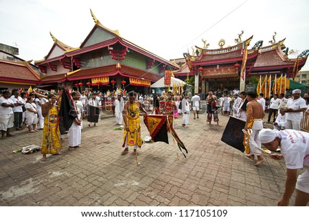 PHUKET, THAILAND - OCT 20 : A Taoist devotee participates in the Phuket Vegetarian Festival on Oct 20, 2012 in Phuket, Thailand. The festival ritual mortification is practiced to appease the Gods. - stock photo