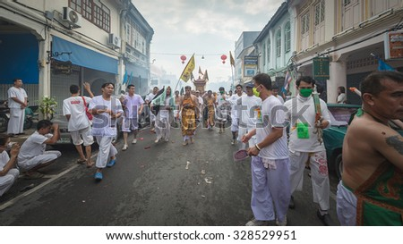 Phuket, THAILAND-OCT 18:A typical scene of Thai Chinese worshipers waiting for the parade of the Phuket Vegetarian Festival in Phuket Town - on October 18, 2015 in Phuket, Thailand