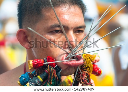 PHUKET, THAILAND- OCT 23: Unidentified participant the parade on October 23, 2012 Vegetarian Festival Phuket Thailand. The Festival is a famous annual festival also known as Nine Emperor Gods festival - stock photo
