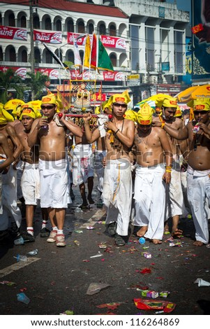 PHUKET, THAILAND - OCTOBER 21: An unidentified group of people in street processions of Phuket Vegetarian Festival on October 21, 2011 in Phuket, Thailand. It is an annual Taoist celebration event.