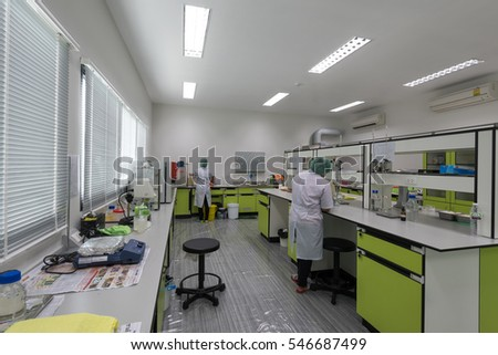 PHUKET, THAILAND - OCTOBER 11 : Technicians working in a laboratory testing of rubber products on OCTOBER 11, 2016, in Phuket Thailand.