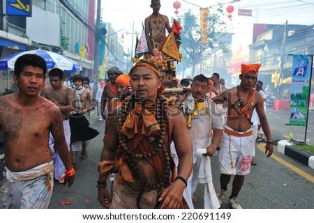 PHUKET, THAILAND - SEPTEMBER 30: A typical scene of Thai Chinese worshippers waiting for the parade of the Phuket Vegetarian Festival in Phuket Town, Phuket, Thailand on the 30th September, 2014.
