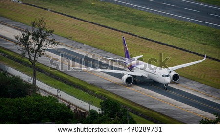 Phuket, Thailand - September 28 ,2016 : Thai  airways airplane , airbus 350-xwb, taxi for take off after incident at phuket airport few days ago