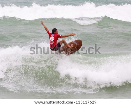 PHUKET, THAILAND - SEPTEMBER 15: unidentified  surfer races the Quiksilver Open Phuket Thailand on September 15, 2012 at Patong Beach in Phuket, Thailand