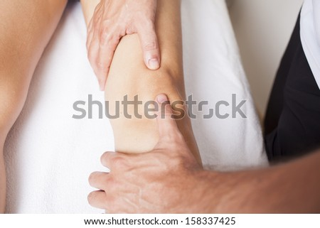 physical therapist applying myofascial therapy    - stock photo