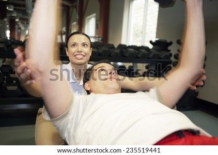 Physical Therapist Helping a Patient Lift Weights - stock photo