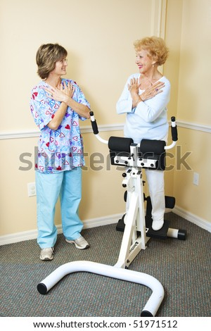 Physical therapist working with a chiropractic patient to improve her spine flexibility.