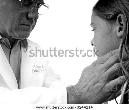 Physician Examining Girl During Check-Up - stock photo