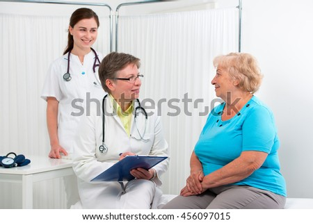Physician explaining diagnosis to elderly patient at the office - stock photo