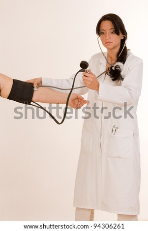Physician measures the blood pressure at the arm of a patient /Measuring blood pressure - stock photo