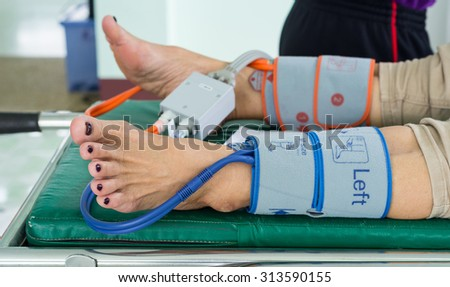 Physician measuring blood pressure to make a diagnosis - stock photo