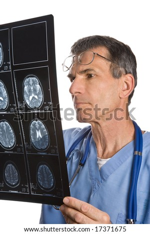 Physician reading and reviewing a MRI brain scan
