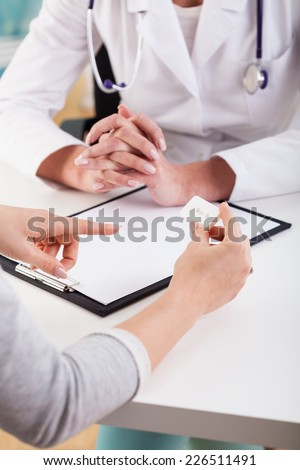 Physician talking with a patient about a medical test - stock photo
